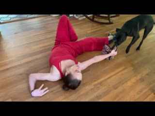 Fiona Apple dancing and playing with her dog