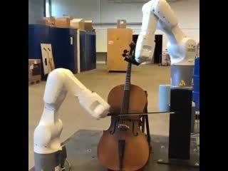 Робот умеющий играть на скрипке!
