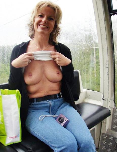Milfs flashing tits on vacation